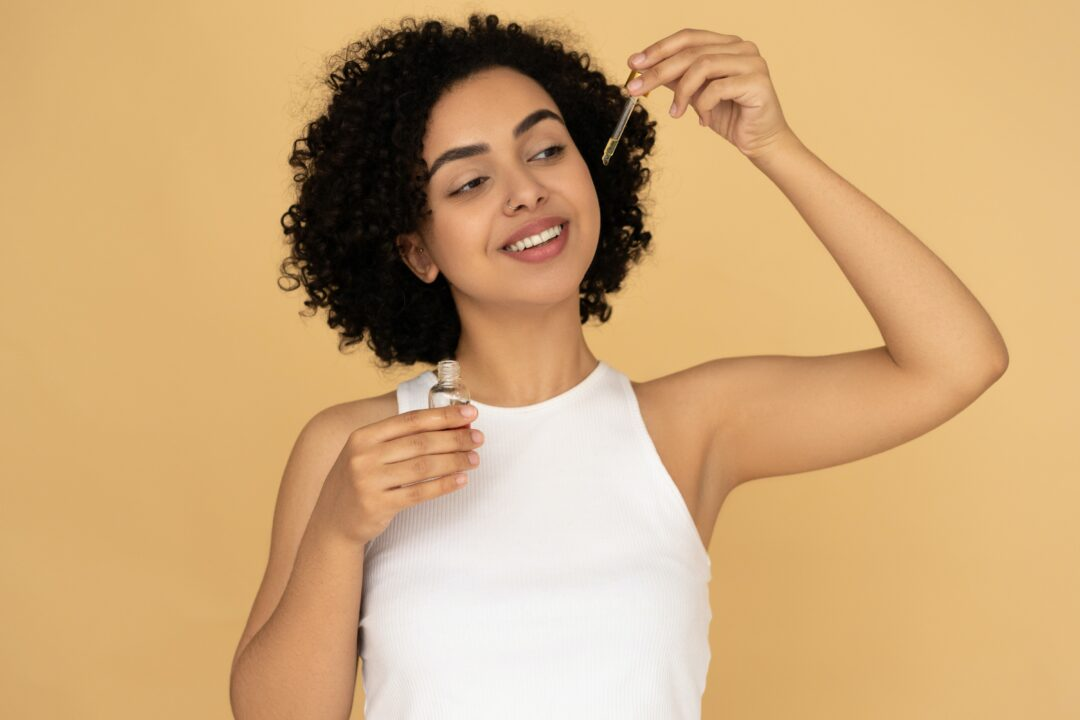 woman holding essential oils